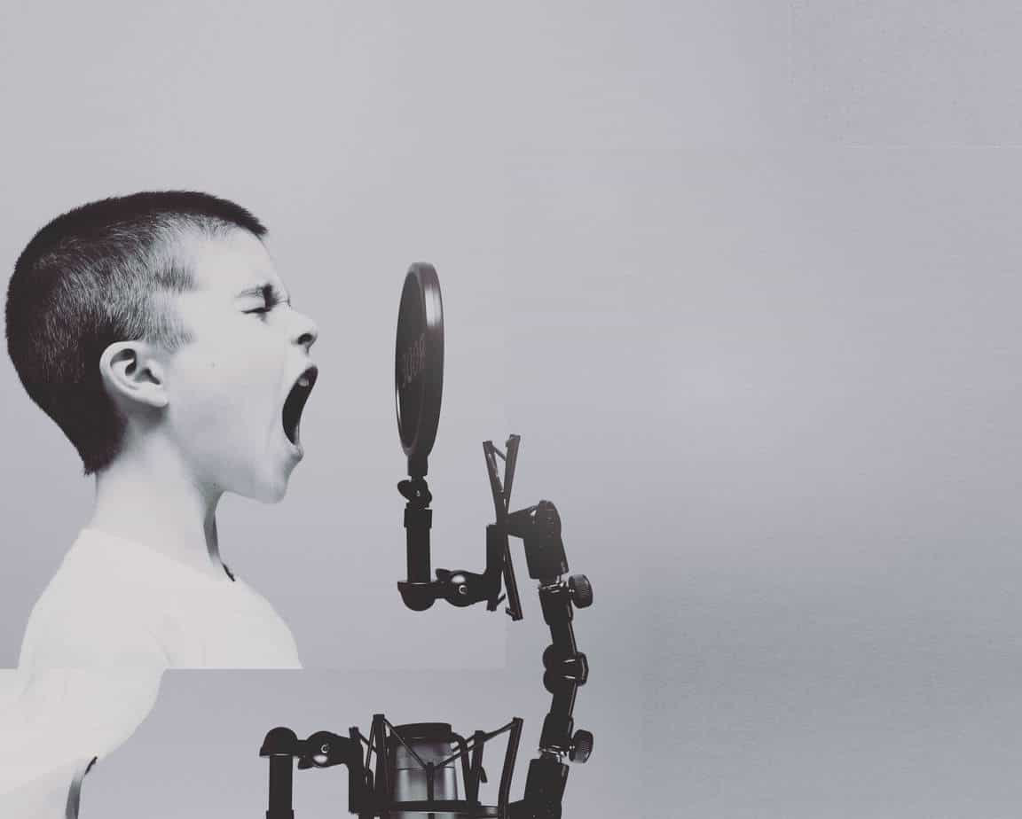 Design agency image of a boy at a microphone