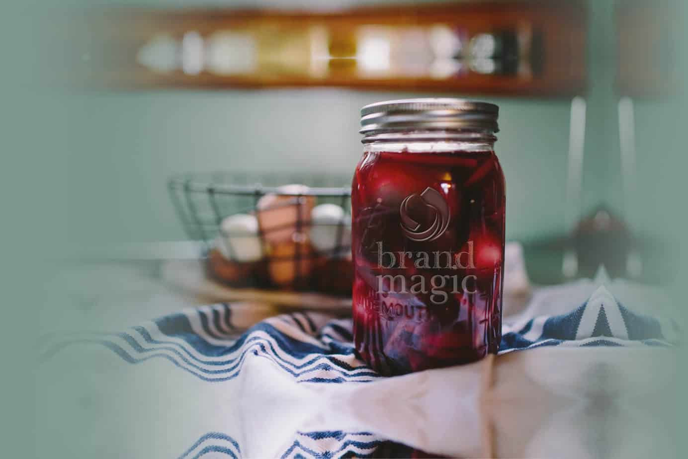 An image of a jam jar with the brand magic logo on, very design agency
